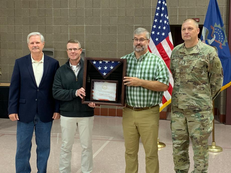 September 2019 - Senator Hoeven honoring the service of Company A, 164th Engineer Battalion as they received the Valorous Unit Award.