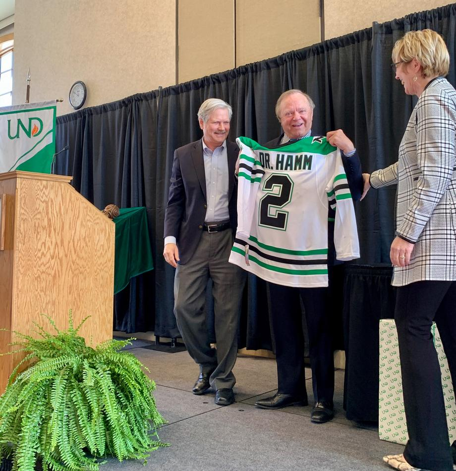 February 2020 - Senator Hoeven presents Harold Hamm with a UND hockey jersey after he received an honorary doctorate.